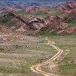 Old rural road in desert mountain — Stock Photo