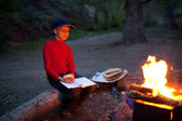 Boy and night camp — Stock Photo