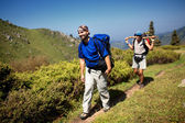Backpackers in mountain — Stock Photo