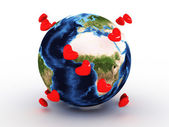 Planet earth with hearts — Stock Photo