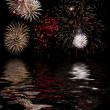 Fireworks ower water - Stock Photo