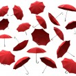 Red flying umbrellas — Stock Photo