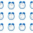 Stock Photo: Twelve blue alarm clock's