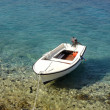 Boat on turquoise sea — Stock Photo