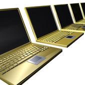Laptops dourados em linha — Fotografia Stock