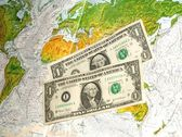 Dollar on map — Stock Photo