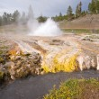 Royalty-Free Stock Photo: Geyser Erupts into a Thermal Stream