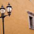 Stock Photo: Street Lamp and Orange Stucco Wall
