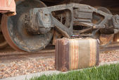 Antique Suitcase and Train Wheels — Stock Photo