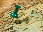 Green pushpin on a map — Stock Photo