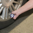 Low tire pressure - Stock Photo
