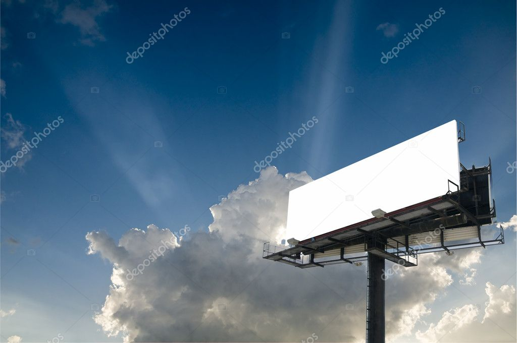 Blank double back to back billboard with sun beam bursts in a partly cloudy sky  Stock Photo #2760243
