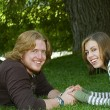 Young couple holding hands in the Park — Stock Photo