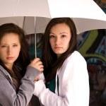 Two Teenage Girls Under an Umbrella — Stock Photo