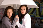 Two Teenage Girls Under an Umbrella — Stock Photo