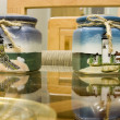 Lighthouse Candle Holders on glass - Stock Photo