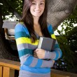 Beautiful Teenager holding a Book — Stock Photo