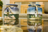 Lighthouse Candle Holders on glass — Stock Photo