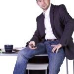 empresario sentado en su escritorio — Foto de Stock