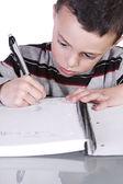 Roztomilý chlapeček, nácvik psaní — Stock fotografie