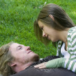 Young couple hugging in a park — Stock Photo