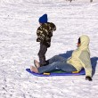 Mother and Son Sledding down the Hill — Stock Photo #2776011