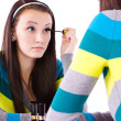 Teenager Putting on Make Up - Stockfoto