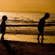 Kids playing on te Beach — Stock Photo