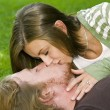 Young couple kissing in the Park — Stock Photo