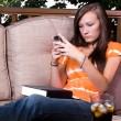 Beautiful Girl Texting in the Patio — Stock Photo #2862942