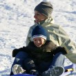 Happy Mother and Son Sledding — Stock Photo