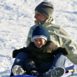 Happy Mother and Son Sledding — Stock Photo #2903466