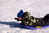 Little Boy Sledding down the Hill — Stock Photo