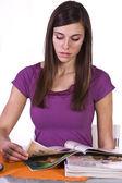 Beautiful Woman Reading a Magazine — Stock Photo