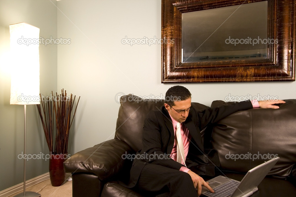 Home or Office - Businessman with his Glasses working on the Couch — Stock Photo #2903496