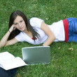 Cute teen girl laying down on the grass — Stock Photo