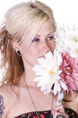 Beautiful Girl Smelling Flowers — Stockfoto