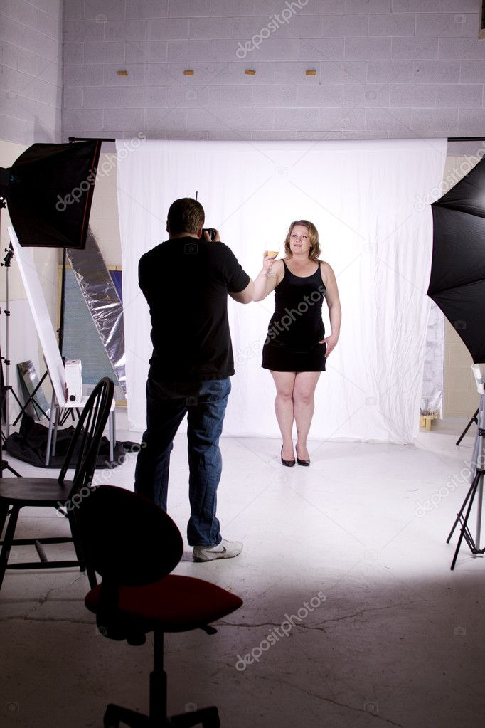 Photographer Taking Pictures of a Model in the Studio  Stock Photo #3005484