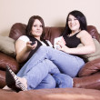 Two Girls Sitting on the Sofa — Stock Photo