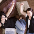 Two Girls on the Couch Shopping Online — Stock Photo