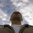 Man Looking up with the Clouds — Stock Photo