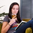 Cute Girl Drinking while Reading a Book — Stock Photo