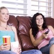 Two Girls Sitting on the Sofa — Stock Photo #3318279