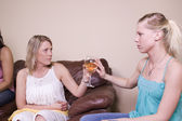 Mother Offering a Drink to her Daughter — Stock Photo