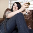 Woman Sitting on the Couch — Stock Photo