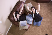 Two Girls on the Couch Shopping — Stock Photo