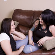Two Girlfriends Sitting on the Couch — Stock Photo