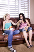 Two Girls Sitting on the Sofa Watching a Movie — Stock Photo