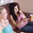Two Girls Sitting on the Sofa Watching a Movie — Stock Photo #3801240