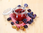 Jar of plum preserve — Stock Photo